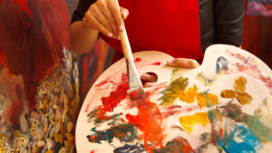 painter's palette with many colors of paint